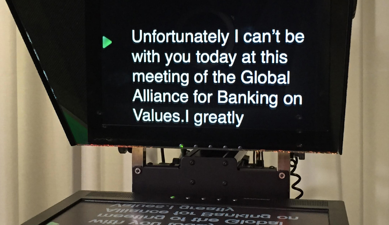 A teleprompter on a camera with the text for the presenter on screen.